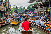 Bangkok, Thailand - December 30, 2013: people on boats at Amphawa Bangkok floating market at Bangkok, Thailand on december 30th, 2013
