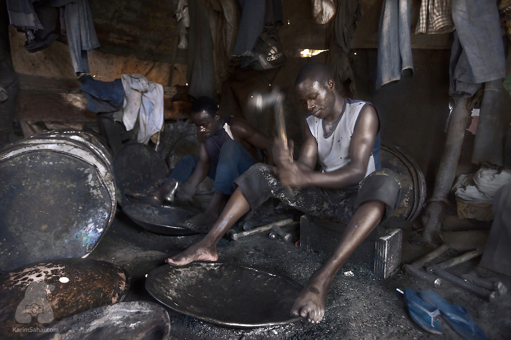 Blacksmiths recycle lids of old oil barrels into frying pans at 'Cooperative des Forgerons' in Bamako, Mali.