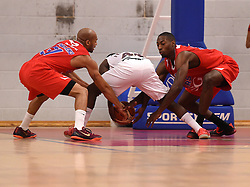 Tyrone Lee of Bristol Flyers and Cardell McFarland of Bristol Flyers battle for the ball with Rahmon Fletcher of Newcastle Eagles   - Photo mandatory by-line: Joe Meredith/JMP - Mobile: 07966 386802 - 10/10/2015 - BASKETBALL - SGS Wise Arena - Bristol, England - Bristol Flyers v Newcastle Eagles - British Basketball League