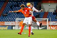 12-11-2015 VOETBAL:JONG ORANJE-JONG WIT RUSLAND:TILBURG<br /> Koning Willem II Stadion EK-kwalificatiewedstrijd<br /> <br /> Aleksei Teslyuk in duel met Jong oranje speler Tony Vilhena (Feyenoord) <br /> <br /> Foto: Geert van Erven