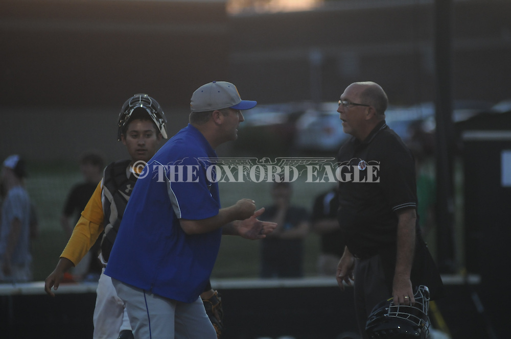 Oxford High's Chris Baughman argues the out call on William Elliott and gets ejected vs. Hernando in MHSAA Class 5A baseball playoff action in Hernando, Miss. on Monday, May 13, 2013. Hernando won game 2, 4-1.
