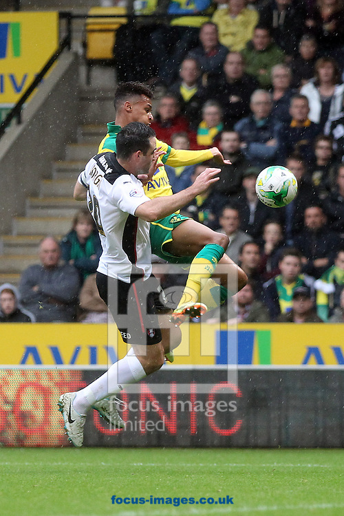 Josh Murphy of Norwich and Craig Morgan of Rotherham United in action during the Sky Bet Championship match at Carrow Road, Norwich<br /> Picture by Paul Chesterton/Focus Images Ltd +44 7904 640267<br /> 04/10/2014