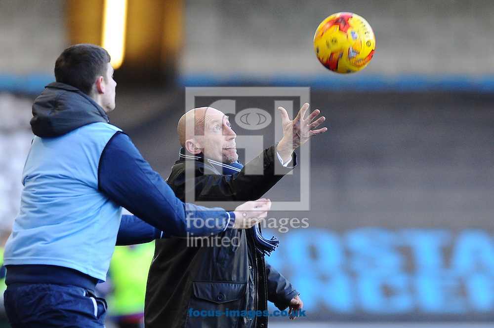Ian Holloway of Millwall attempts to catch the ball ahead of the ballboy during the Sky Bet Championship match at The Den, London<br /> Picture by Seb Daly/Focus Images Ltd +447738 614630<br /> 17/01/2015
