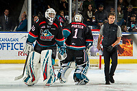 KELOWNA, CANADA - DECEMBER 1:  Roman Basran #30 heads to the bench with athletic therapist Scott Hoyer as James Porter #1 of the Kelowna Rockets heads to the net against the Saskatoon Blades on December 1, 2018 at Prospera Place in Kelowna, British Columbia, Canada.  (Photo by Marissa Baecker/Shoot the Breeze)