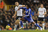Nabil Bentaleb of Tottenham Hotspur does battle with Willian of Chelsea during the Barclays Premier League match between Tottenham Hotspur and Chelsea  at White Hart Lane, London<br /> Picture by Richard Blaxall/Focus Images Ltd +44 7853 364624<br /> 01/01/2015
