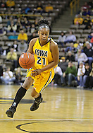 February 24 2011: Iowa Hawkeyes guard Kachine Alexander (21) with the ball during the first half of an NCAA women's college basketball game at Carver-Hawkeye Arena in Iowa City, Iowa on February 24, 2011. Iowa defeated Illinois 83-64.