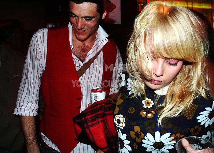 Couple dancing at nightlife venue in Bloomsbury, UK, 1990s.