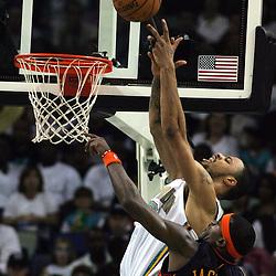 New Orleans Hornets center Tyson Chandler #6 dunks over Golden State Warriors forward Stephen Jackson #1 in the second quarter of their NBA game on April 6, 2008 at the New Orleans Arena in New Orleans, Louisiana.