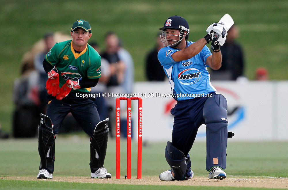 Aces Dusan Hakaraia hits the ball as Stags keeper Kryger Van Wyk watches. Twenty20 Cricket - HRV Cup, Auckland Aces v Central Stags, at Colin Maiden Park, Auckland, Friday 03 December 2010. Photo: Simon Watts/photosport.co.nz