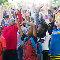 Pierce Street students wave up at the photographer, communication assistant Ryan Coon, as he takes a photo  from a bucket truck while students and staff spell out 'PSE 50th' Friday morning at the elementary school. The photo was taken to commemorate the 50th anniversary of the school.