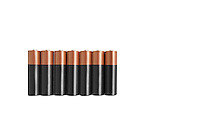 Close-up of batteries in a row over white background