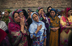 October 5, 2018 - Srinagar, Jammu and Kashmir, India - Neighbors and relatives mourn on seeing the body of Nazir Ahmad one of the members of the regions oldest pro India political party, the National conference, killed by unidentified gunmen, during his funeral,  on October 5, 2018 in Srinagar, the summer capital of Indian administered Kashmir, India.  Two members of the regions oldest pro India political party, the National conference (NC), were shot dead while another was wounded by unidentified assailants in Karfali Mohalla area of summer capital city Srinagar. Local news agency reported that the militants attacked the close aides of NC Member Legislative Assembly for Habba Kadal constituency Shimami Firdous at Karfali Mohalla. The slain were identified as Mushtaq Ahmad Wani and Nazir Ahmed Wani. India has announced local body polls in the region from October 8 but major pro Indian parties Including the NC have  decided to boycott  the polls over what they term New Delhi's attempt to alter the demography of the disputed Himalyan region  (Credit Image: © Yawar Nazir/ZUMA Wire)