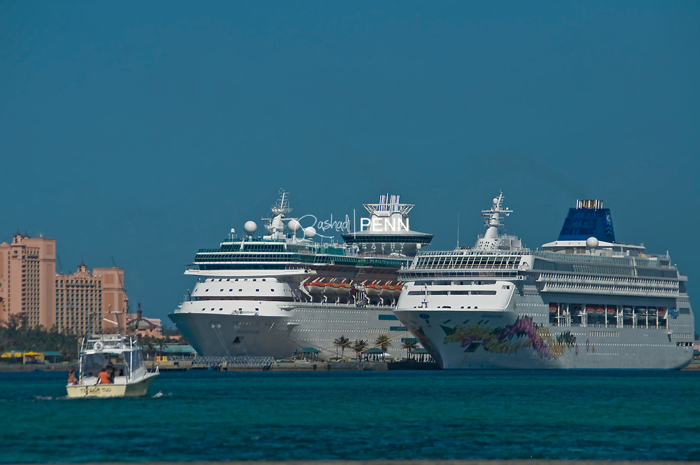 Junkanoo Beach and Cruise ships on a saturday with local Bahamians enjoying the cool waters.
