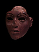 Part of a face from a statue face (possibly of Queen Tye (Tiye), mother of Akhenaten. 18th Dynasty reign of Akhenaten. circa 1353-1336 BC made from Yellow jasper in the Amarna Style