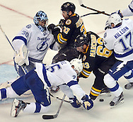 (BOSTON MA 022816)-The Bruins Brad Marchand and Patrice Bergeron crash the Lightning goal resulting in a penalty to Bergeron in the second period. Herald photo Chris Christo