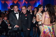 DAVID FURNISH; SIR ELTON JOHN, Grey Goose character and cocktails. The Elton John Aids Foundation Winter Ball. off Nine Elms Lane. London SW8.  chef Marcus Wareing was in charge of dinner.30 October 2010. -DO NOT ARCHIVE-© Copyright Photograph by Dafydd Jones. 248 Clapham Rd. London SW9 0PZ. Tel 0207 820 0771. www.dafjones.com.