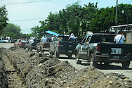 Convoy of self-defense forces driving to different positions in the hills of Michoacan.