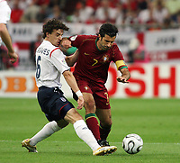 Photo: Chris Ratcliffe.<br /> England v Portugal. Quarter Finals, FIFA World Cup 2006. 01/07/2006.<br /> Owen Hargreaves of England clashes with Figo of Portugal.