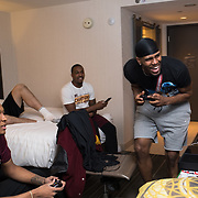 Loyola University Chicago Men's Basketball players play video games in their hotel room in Dallas, TX., on Tuesday, March 13, 2018, while on the road to the NCAA Tournament. This is the basketball team's first appearance since 1985. (Photo: Lukas Keapproth)