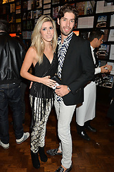 ROCCO PLESSI and CAMILLA SANTIN at a party to celebrate the launch of the Maison Assouline Flagship Store at 196a Piccadilly, London on 28th October 2014.  During the evening Valentino signed copies of his new book - At The Emperor's Table.