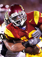 1 September 2007: Tailback #13 Stafon Johnson in action during the USC Trojans college football team defeated the Idaho Vandals 38-10 at the Los Angeles Memorial Coliseum in CA.  NCAA Pac-10 #1 ranked team first game of the season. Johnson is wearing a special eye patch dedicated to Big Dad, his deceased grandfather this season.