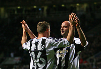 Photo: Andrew Unwin.<br /> Newcastle United v Celta Vigo. UEFA Cup. 23/11/2006.<br /> Newcastle's Antoine Sibierski (R) celebrates his goal with James Milner (L).