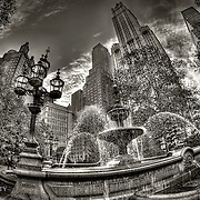 A black and white fisheye view of City Hall Park in New York.