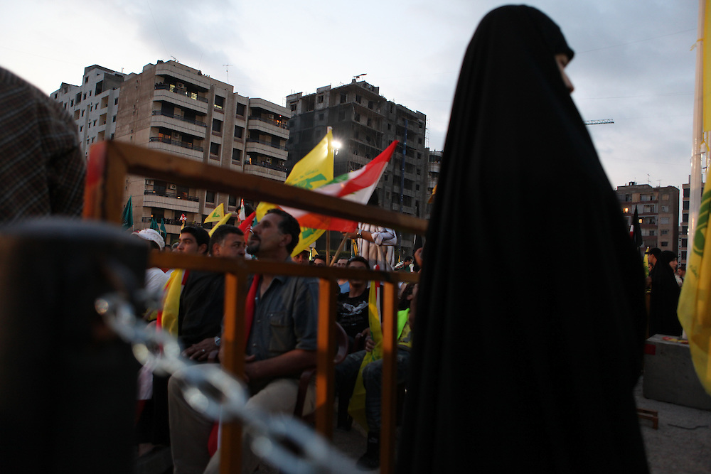 Supporters of the Shiite resistance and political group, Hizballah, rallied in the Dahiyeh southern suburbs of Beirut to watch a televised speech from Hizballah General Secretary Hassan Nasrallah. The rally was called for by Hizballah to celebrate Land Day, which is the 9th anniversary of Israel's withdrawal from southern Lebanon, which Hizballah and its supporters say was a victory over Israel. The rally comes just 13 days before Lebanese go to the polls to elect a new parliament. With Sunni Muslims and Shia Muslims mostly supporting their respective sectarian parties, Nasrallah praised Christian leader Michel Aoun. Aoun is head of the Free Patriotic Movement, which is allied with the Hizballah-led opposition March 8 coalition. ///A woman security officer stands guard at the rally.