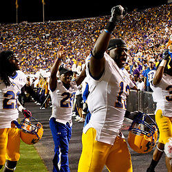 October 16, 2010; Baton Rouge, LA, USA; McNeese State Cowboys players celebrate as they run off the field at halftime against the LSU Tigers at Tiger Stadium.  Mandatory Credit: Derick E. Hingle