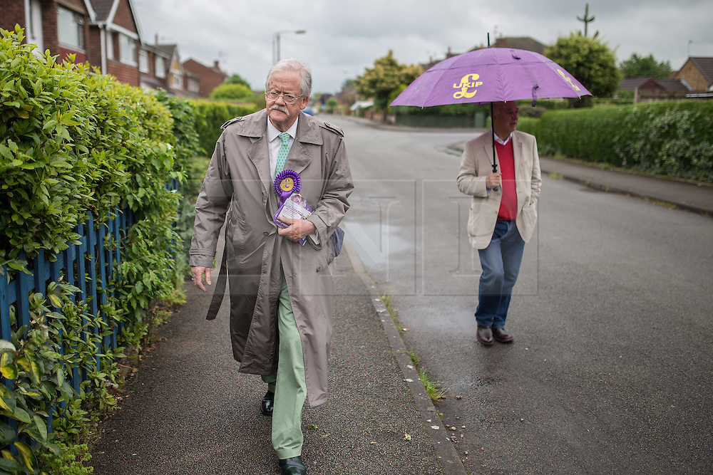 © Licensed to London News Pictures . 04/06/2014 . Bingham , Nottinghamshire , UK . UKIP candidate ROGER HELMER (left) out knocking doors in Bingham today (Wednesday 4th June 2014) ahead of the Newark by-election tomorrow (Thursday 5th June 2014) . Photo credit : Joel Goodman/LNP