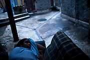 A young resident  sleeps in a couch on an aisle in  Providencia slum in the port area of Rio de Janeiro, Brazil, Friday, March 1, 2013.  The community formed in this location is considered to be the first favela in the city. At the end of the 19th century, the hill was called Morro da Favela, the name that is now used for all irregular constructions.Its first residents were ex-combatants in the Canudos War and settled there around 1897. Some 10 thousand soldiers came to Rio after the government promised them they would receive houses in the then federal capital, but political and bureaucratic red tape led to delays in construction of the residences. So, the ex-combatants began to occupy the hillside temporarily, and ended up staying there.