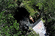 Sinkhole cliff diving competition held in Mexico<br /> <br /> Daredevil athletes have jumped from the edge of a 90ft deep sinkhole in a remote part of Mexico, as part of a cliff diving contest.<br /> Divers in the 'Cliff Diving World Series' performed stunts and reached speeds of 40mph before hitting the dark water of Cenote Ik Kil.<br /> Gary Hunt, from Southampton was the overall winner and managed to pull off a Triple Quad – one of the most difficult dives in the world.<br /> The Red Bull event lasted for two days -- though most of that time was probably taken up trying to get back out after each jump. <br /> Gary scored 373.85 and edged out second-placed Silchenko by a little over 10 points, with 2009 champion Duque taking third place.<br /> <br /> Photo Shows: Michal Navratil of Czech Republic dives from the 27.2 metre platform during round two of the 2010 Red Bull Cliff Diving World Series, Cenote Ik Kil, Yucatan, Mexico on June 05; 2010.<br /> (©Ray Demski/Exclusivepix)