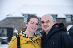 © Licensed to London News Pictures Ltd.  01/02/2019. Bodmin Moor, UK. Jodie Oats 26 and Andrew Gool had to abandon their car and had to take refuge overnight in the Jamaica Inn with their small child<br /> Rescue crews help stranded motorists on the A30 on Bodmin Moor, who were stranded last night by heavy snowfall. Most motorists were put the up on camp beds in the nearby Jamaica Inn. Photo credit: Mark Hemsworth/LNP
