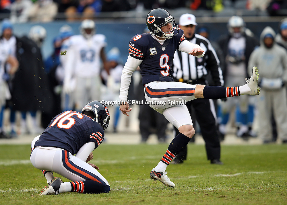 Chicago Bears punter Pat O'Donnell (16) holds while Chicago Bears kicker Robbie Gould (9) kicks a 34 yard field goal that cuts the Detroit Lions lead to 24-20 in the fourth quarter during the NFL week 17 regular season football game against the Detroit Lions on Sunday, Jan. 3, 2016 in Chicago. The Lions won the game 24-20. (©Paul Anthony Spinelli)