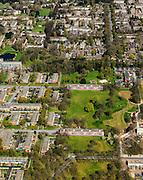 Nederland, Drenthe, Emmen, 01-05-2013; Angelslo, nieuwbouwwijk uit de jaren zestig van de twintigste eeuw, wederopbouwperiode. Groenzones met laagbouw (strokenbouw).<br /> Kenmerkend is de indeling in buurten en woonerven, scheiding van functies (wonen, werken, verkeer). Rationalistische architectuur, groen en ruimte. <br /> New residential area in Emmen built in the sixties during the period of Reconstruction after World War II, characteristic of the division into neighborhoods and residential precincts, separation of functions (living, working, traffic). Rationalist architecture.<br /> luchtfoto (toeslag op standard tarieven)<br /> aerial photo (additional fee required)<br /> copyright foto/photo Siebe Swart