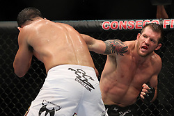 September 24, 2010; Indianapolis, IN; USA; Ryan Bader (black/white trunks) and Antonio Rogerio Nogueira (white trunks) during their bout at UFC 119 at the Conseco Fieldhouse in Indianapolis, IN. Bader won via unanimous decision.
