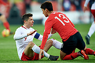 Chorzow, Poland - 2018 March 27: (L) Robert Lewandowski from Poland looks at (R) Jung Woo-young from South Korea while Poland v South Korea International Friendly Soccer match at Stadion Slaski on March 27, 2018 in Chorzow, Poland.<br /> <br /> Mandatory credit:<br /> Photo by © Adam Nurkiewicz / Mediasport<br /> <br /> Adam Nurkiewicz declares that he has no rights to the image of people at the photographs of his authorship.<br /> <br /> Picture also available in RAW (NEF) or TIFF format on special request.<br /> <br /> Any editorial, commercial or promotional use requires written permission from the author of image.