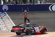 Feb. 20, 2010; Fontana, CA, USA; NASCAR Nationwide Series driver Kyle Busch celebrates after winning the  Stater Brothers 300 at Auto Club Speedway. Mandatory Credit: Jennifer Stewart-US PRESSWIRE