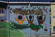 """Mural painted by different organizations and artists on the fence surrounding the Historic National Police Archives reads: """"Memory, Life"""". On July 5, 2005, the historical archives of the now dissolved National Police were found in an abandoned arms depot in the outskirts of Guatemala City. The discovery of these millions of documents, which were allegedly lost after the 1996 Peace Accords, provide important evidence in the search for the thousands of people who were detained and subsequently disappeared by State security forces during the internal armed conflict (1960-1996). Guatemala City, Guatemala. December 13, 2011."""