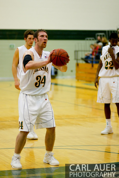 1/13/2006: Junior forward Carl Arts (34) of the UAA Seawolves at the line as he sets a career high 27 as he leads Alaska Anchorage to a comeback victory over Northwest Nazarene, 60-57, in men?s basketball action at the Wells Fargo Sports Complex on Saturday.