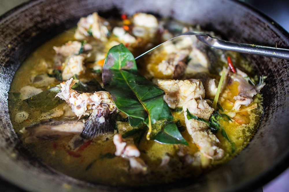 Yosua's homemade cooking, fish in a savory broth, made with his own recipe.
