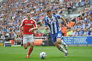 Wigan Striker Yanic Wildschut takes on Barnsley Midfielder Josh Scowen during the Sky Bet League 1 match between Wigan Athletic and Barnsley at the DW Stadium, Wigan, England on 8 May 2016. Photo by John Marfleet.