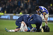 Barry Bannan of Sheffield Wednesday receives attention for an injury  during the Sky Bet Championship match between Hull City and Sheffield Wednesday at the KC Stadium, Kingston upon Hull, England on 26 February 2016. Photo by Ian Lyall.