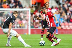 Danny Ings of Southampton is marked by Johann Gudmundsson of Burnley - Mandatory by-line: Ryan Hiscott/JMP - 12/08/2018 - FOOTBALL - St Mary's Stadium - Southampton, England - Southampton v Burnley - Premier League