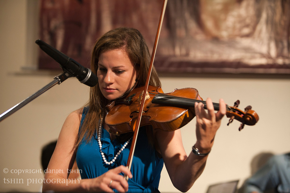Violinist Larisa Spitzer of the worship team leading the Evangelical Church of Bangkok (ECB) during the Easter service on 24 April 2011 in Bangkok, Thailand