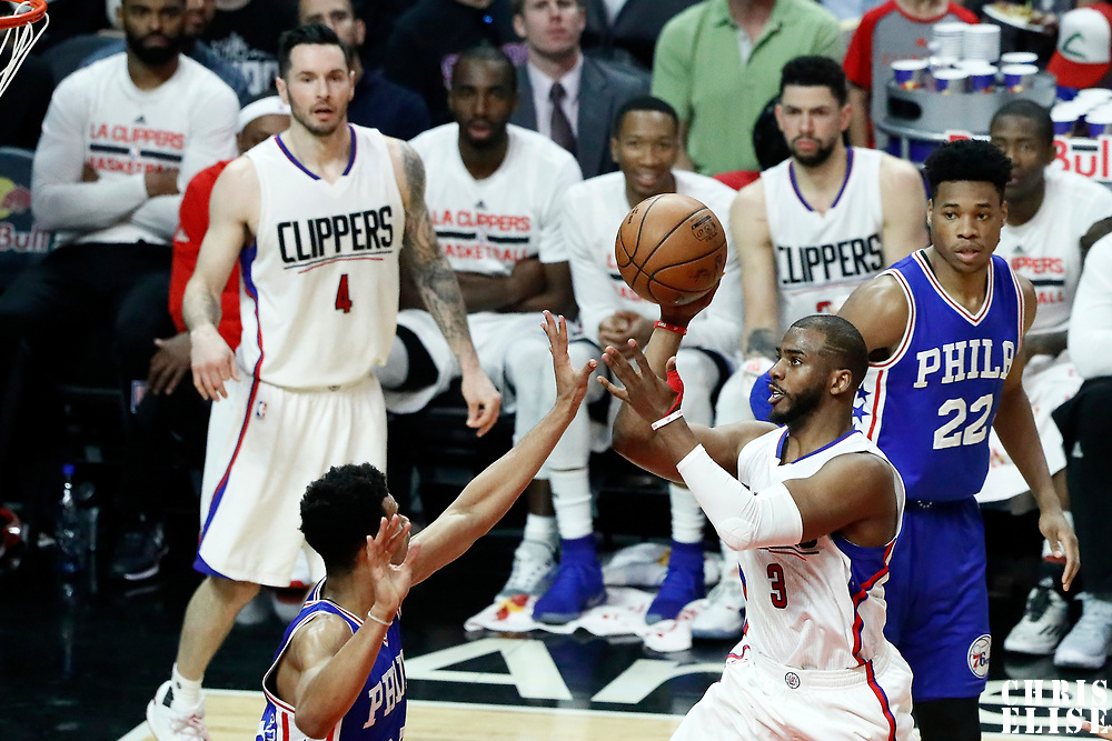 11 March 2017: LA Clippers guard Chris Paul (3) passes the ball over Philadelphia 76ers guard Timothe Luwawu-Cabarrot (20) during the LA Clippers 112-100 victory over the Philadelphia Sixers, at the Staples Center, Los Angeles, California, USA.