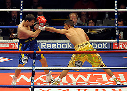 Amir Khan connects with a jab during the WBA Light Welterweight title fight between Amir Khan (Challenger) and Andreas Kotelnik (Champion) at the MEN Arena on July 18, 2009 in Manchester, England.