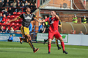 Cambridge United defender Leon Legge and York City defender John McCoombelook for the ball during the Sky Bet League 2 match between York City and Cambridge United at Bootham Crescent, York, England on 3 October 2015. Photo by Simon Davies.
