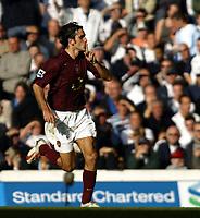 Photo: Chris Ratcliffe.<br />Tottenham Hotspur v Arsenal. The Barclays Premiership.<br />29/10/2005.<br />Robert Pires silences the Spurs fans