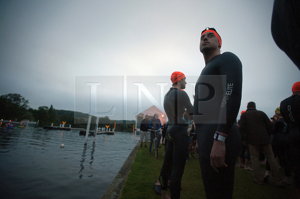 © Licensed to London News Pictures. 26/06/2011. Henley-on-Thames, UK. Competitors waiting at the start line. Swimmers take part in the Henley Swim at dawn this morning (26/06/2011). The annual event sees competitors swim the length of the 2.1km course of the Henley Royal Regatta on the River Thames, after arriving in darkness, and walking half a mile to the start at sunrise. See special instructions. Photo credit should read: Ben Cawthra/LNP